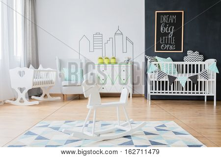 Baby room with scandinavian decor and stylish cradle