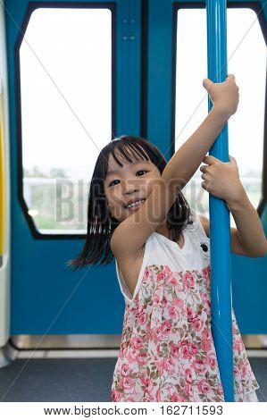 Asian Chinese Little Girl Pole Dancing Inside A Mrt Transit