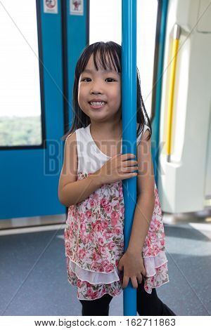 Asian Chinese Little Girl Standing Inside A Mrt Transit