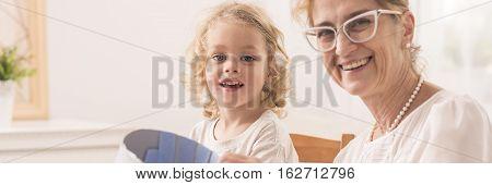 Child Playing With Optimistic Grandma