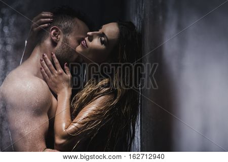 Passionately Hugging Couple In The Shower