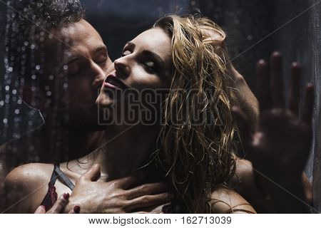 Man Kissing Woman While Showering