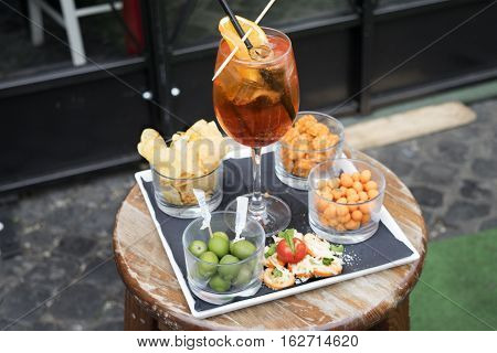 aperitif with snacks olives and french fries