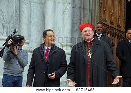 New York, New York- December Twenty First: Cardinal Timothy Dolan and Brian Kilmeade of Fox News on stairs of St. Patrick's Cathedral NYC. December 21st 2016 at St. Patrick's Cathedral on Fifth Avenue between 50th and 51st Street, NYC