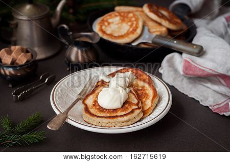 Fluffy Wholemeal Pancakes with Mascarpone on a Plate