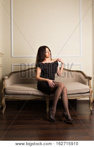 Gorgeous brunette woman in a luxurious classic interior. Beauty fashion