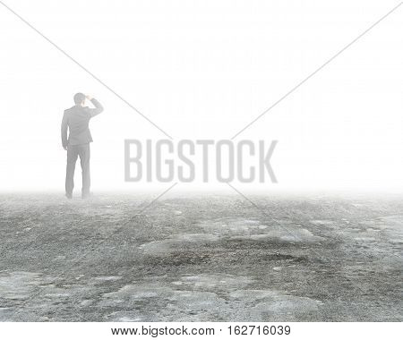 Man Gazing And Standing In Mist On Dirty Concrete Floor