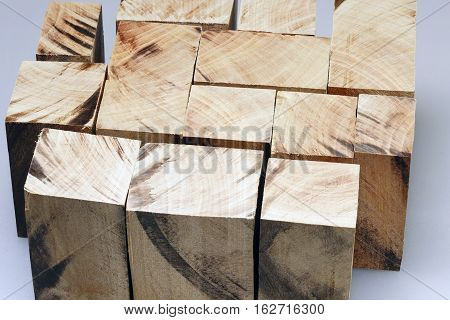 many different size wooden blocks on white