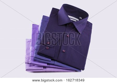 Shirts in purple tones on a white background