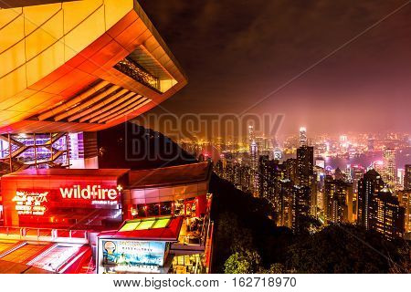 Hong Kong, China - December 7, 2016: close up of Peak Tower and rooftop restaurant by night. The Sky Terrace 428, the viewing platform on top of the Peak Tower, is a icon building in Hong Kong.