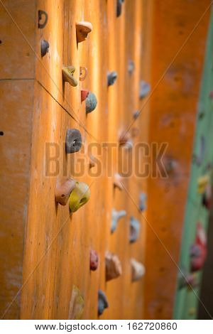 empty bouldering wall with the multicolored grips