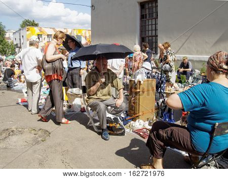 MOSCOW, RUSSIA - July 31, 2016: Buyers and sellers of a flea market on a hot day. July 31, 2016 in Moscow, Russia