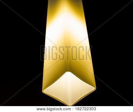 close up of Glowing lamp on black background
