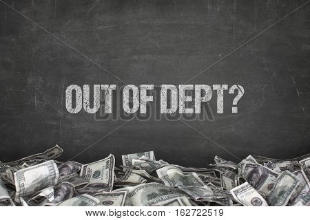 Out of dept text on black background with dollar pile