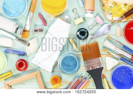 Painting equipment on a green shabby background