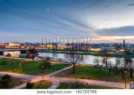 Krakow, Poland - November 4, 2016: The picturesque embankment of the Vistula river in Krakow city, night view