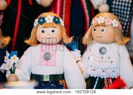 Traditional Souvenirs Ethnic Folk National Wooden Dolls Toys At European Estonian Market. Popular Souvenir From Tallinn, Estonia
