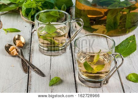 Basil Herbal Tea On Wooden Table