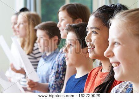 Group Of Children Enjoying Singing Group Indoors