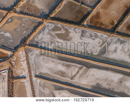 Aerial. Abstract saline lakes views from the sky. Tavira Portugal