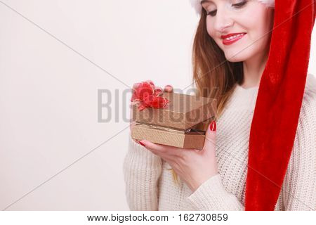 Woman Opening Gift Box. Christmas Time