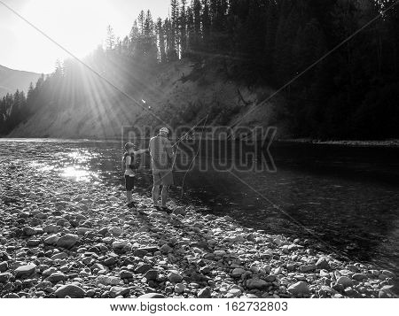 Father showing Son the mastery of fly fishing