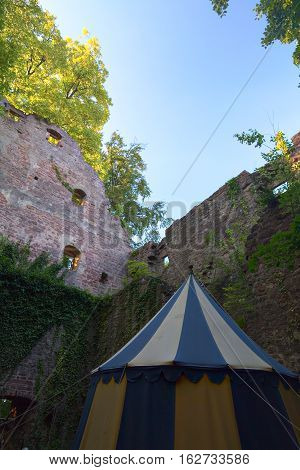 Ruined Part Of Castle Neuenbuerg In Germany With A Medieval Tent