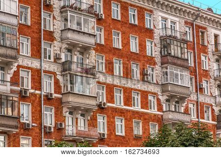 Fragment of a wall of the empire red house of 1952 of construction on Stroiteley Street in Moscow
