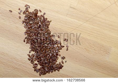 Top View Of Organic Linseed Or Flaxseed (linum Usitatissimum) Isolated On Wood Background.