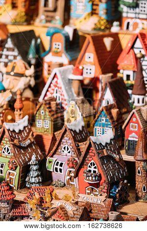 Traditional Souvenirs Small House Toys At European Market. Funny Souvenir From Tallinn, Estonia, Europe.