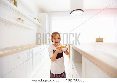 Happy Kid Has Found A Plate Full Of Cookies On Kitchen