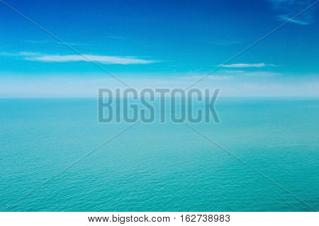 Calm Sea Ocean And Blue Clear Sky Background. Gently Blue And Aquamarine Colors.