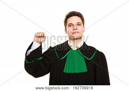Understanding and explaining sending clear message. Young lawyer wear polish toga and show hand sign. Man make gesture with hand hold fist.