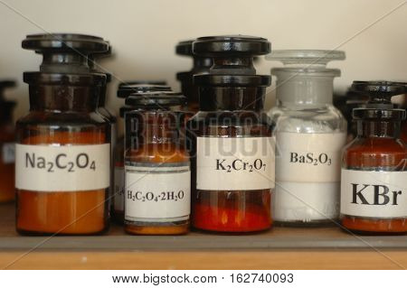 A plurality of containers with different chemicals in a laboratory.