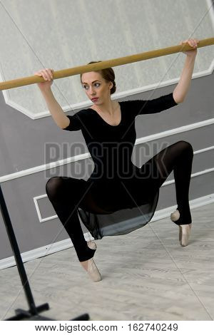 Pretty Young Graceful Ballet Dancer Warms Up In Ballet Class