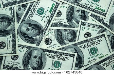 Background of American 100 dollar banknotes close up view of cash money dollars bills in amount