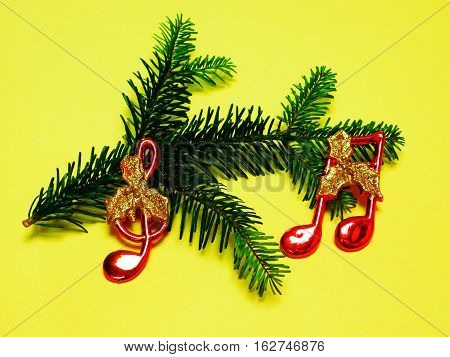 christmas twig of spruce of ornaments musical notes music