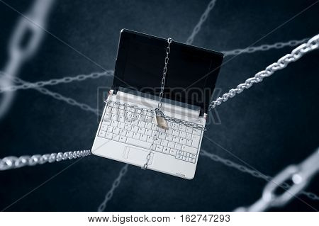 Chained laptop Concept of sensitive data security.