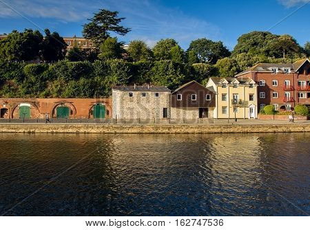 cellars and houses on Exeter Quay. Exe river. Devon. UK
