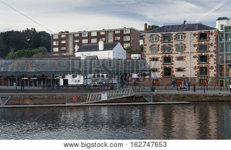 EXETER UK 12 July 2016: buildings and outdoor cafes on the Exeter Quay. Devon.
