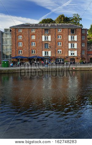 EXETER UK 12 July 2016: four storey building and outdoor cafes on the Exeter Quay. Devon.