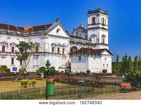 Old Goa, India - November 13, 2012: Unidentified tourists visit to the famous landmark - Roman Catholic Church of St. Francis Assisi