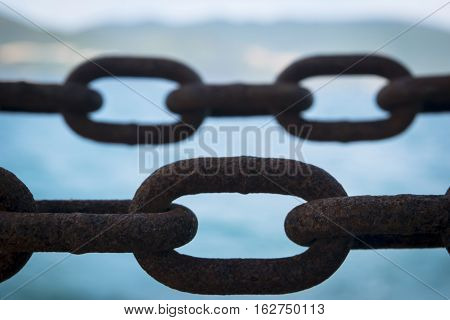 Closeup of a part of the huge old corroded chain