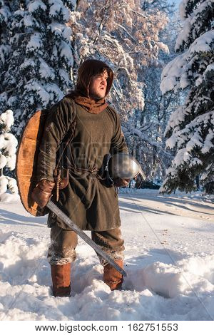 medieval warrior in winter forest in armor