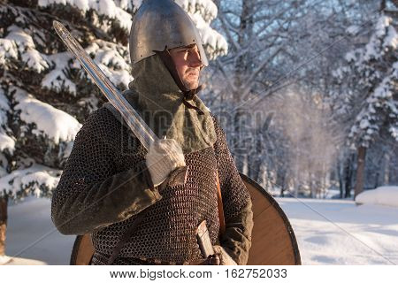 Portrait of a medieval warrior in winter forest