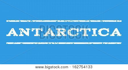 Antarctica watermark stamp. Text caption between horizontal parallel lines with grunge design style. Rubber seal stamp with scratched texture. Vector white color ink imprint on a blue background.