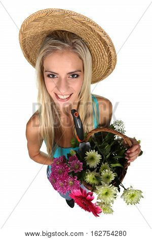 Beautiful young lady with a basket of colorful flowers