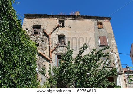 The view of old building with drain system. Corte Corse France.