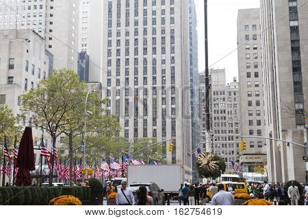 Tourists Crowd Around The New Christmas Tree In Rockefeller Center Which Is Being Prepared For The 2