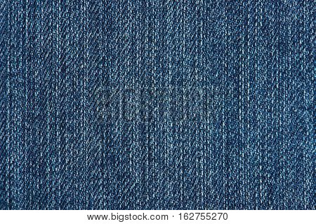 Texture of blue jeans fabric vertical lines. Pattern of blue jeans
